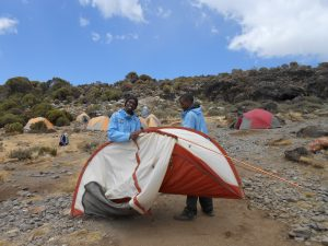Porters putting up tents on Kilimanjaro